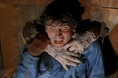the-evil-dead-bruce-campbell-sam-raimi-horror-screenshot-door-buster1